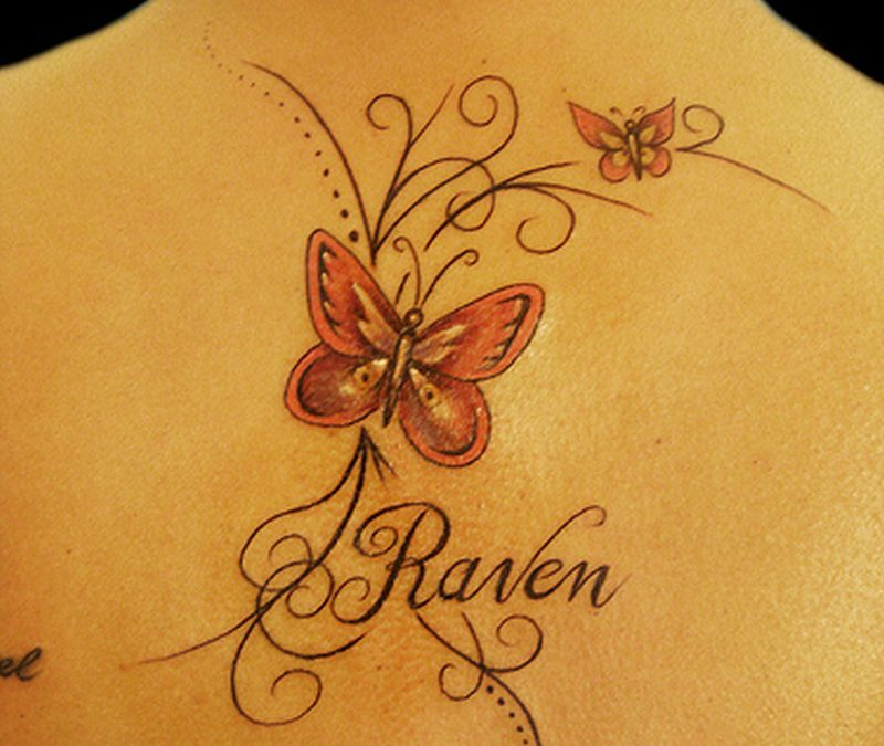 Butterfly tattoo on upper back 2