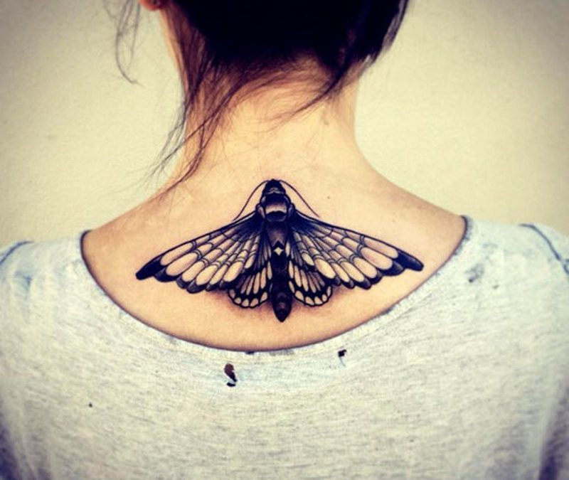Butterfly tattoo on upper back 3
