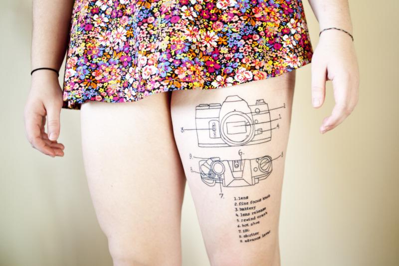 Camera diagram tattoo on thigh