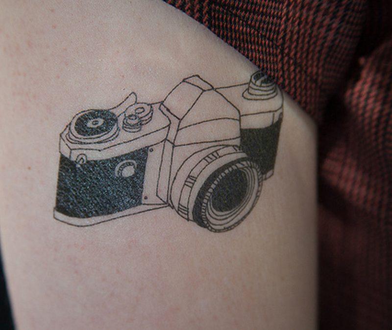 Camera tattoo on thigh