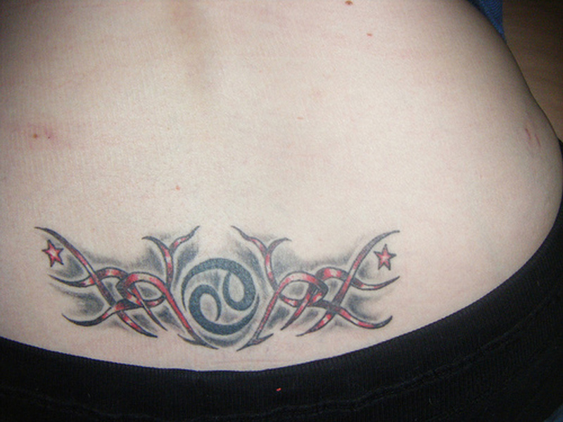Cancer sign tattoo on lower back