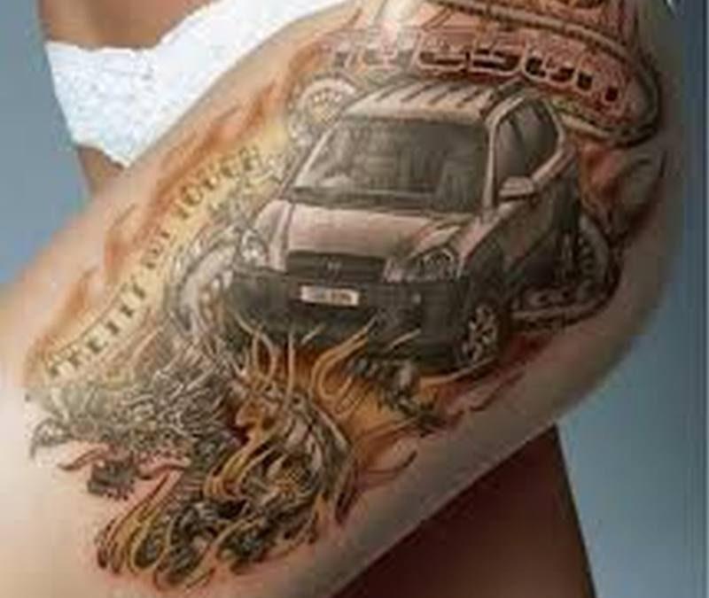 Car tattoo on thigh