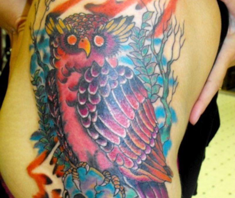 Cartoon owl tattoo