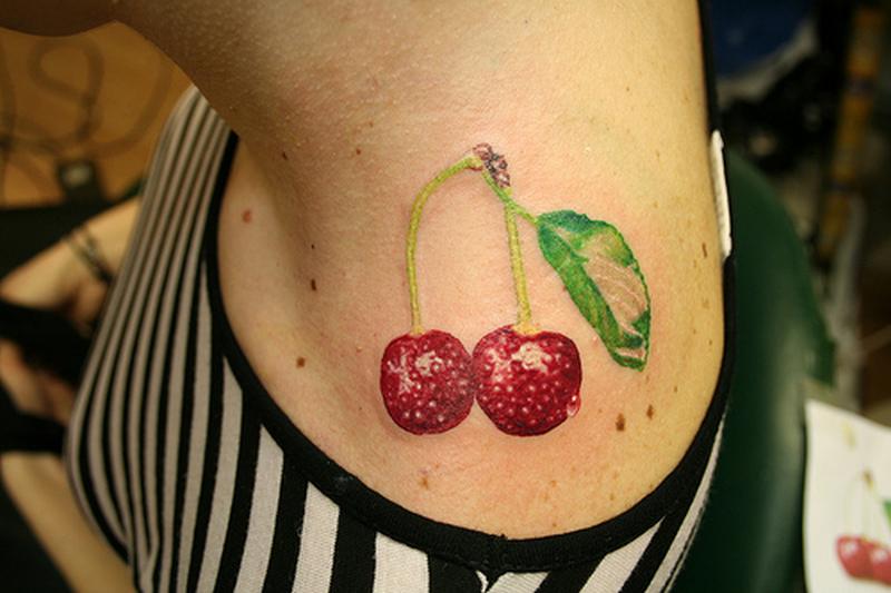 Cherries tattoo design on neck