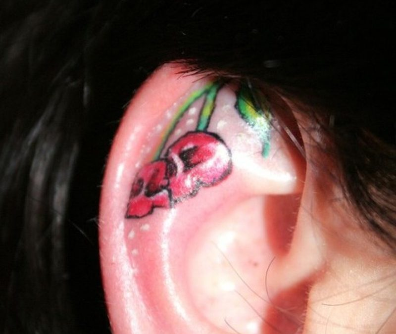 Cherry skull ear tattoo style