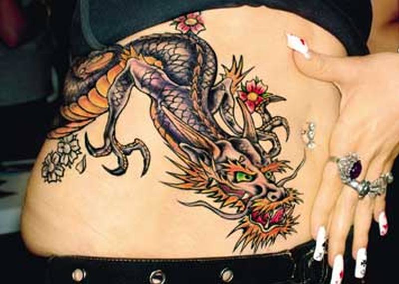 Chinese dragon tattoo on stomach