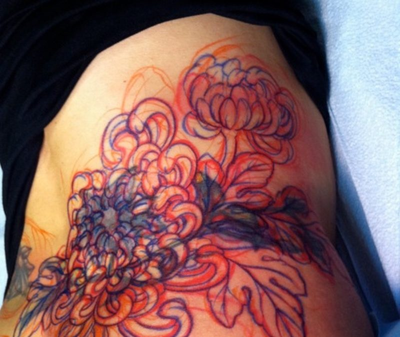 Chrysanthemum tattoo on lower back