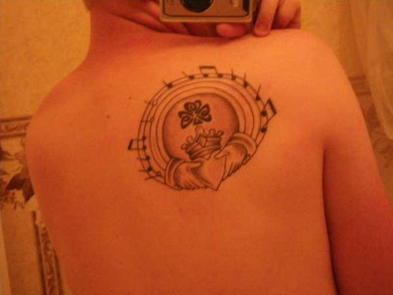 Claddagh shamrock musical score tattoo