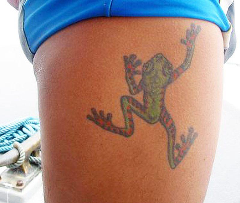 Climbing frog tattoo on thigh