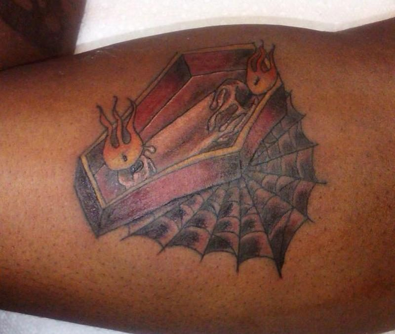 Coffin candle with spider web tattoo design