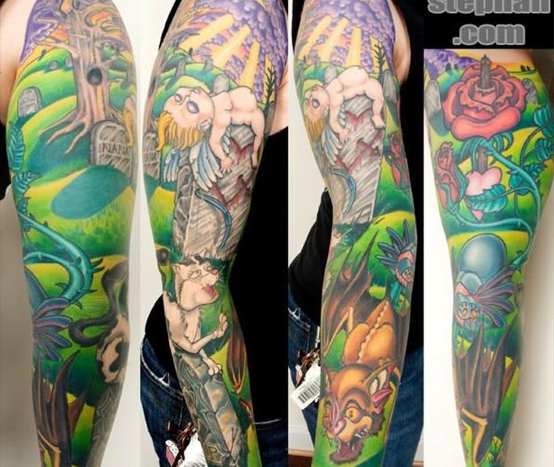 Color ink graveyard tattoo design on sleeve