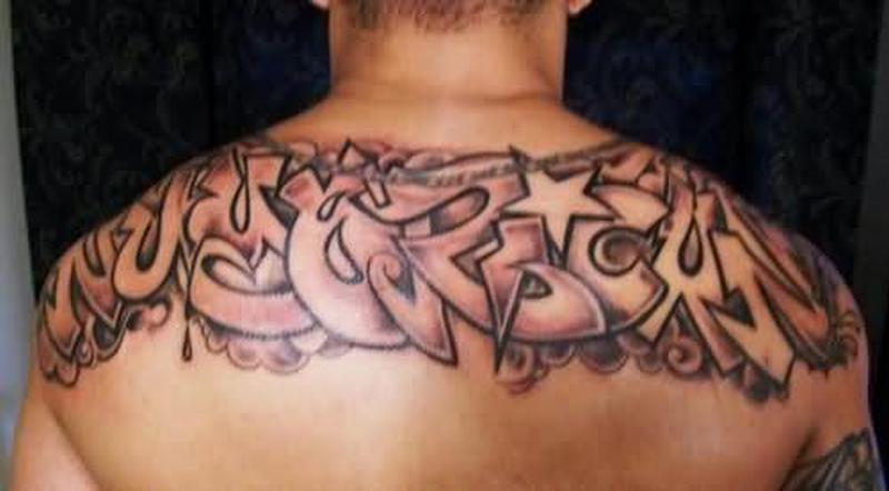 Colorful ambigram upper back tattoo