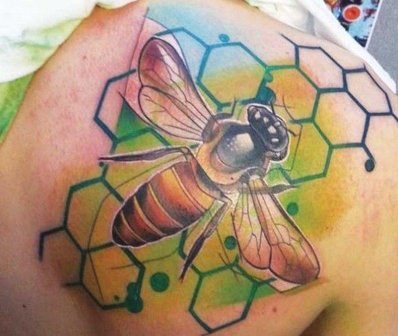 Colorful bee and honeycomb tattoo by Ivana Belakova