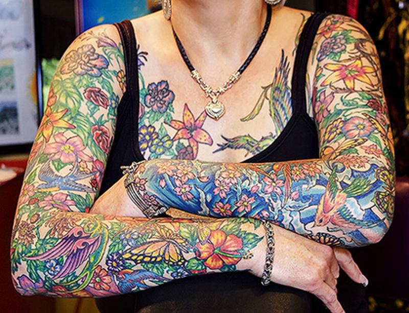 Colorful feminine tattoo designs on sleeve