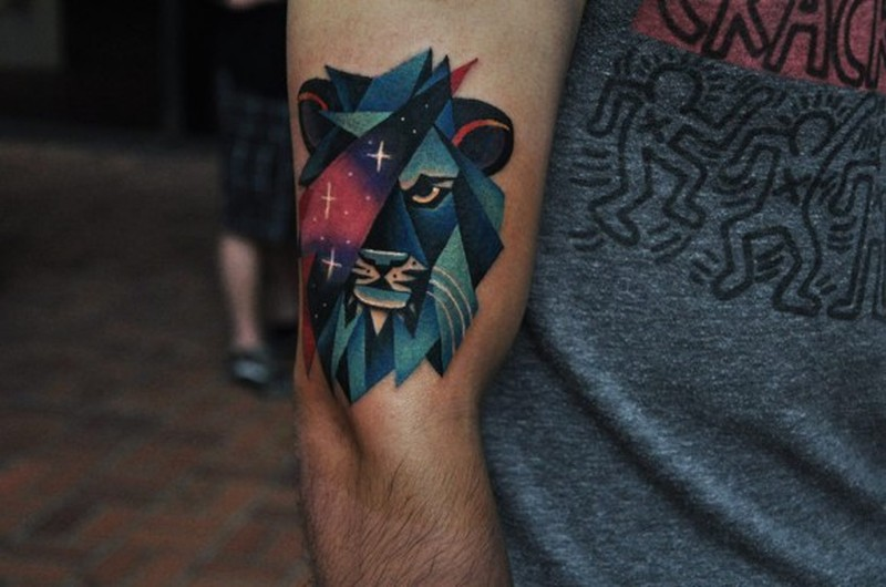 Coloured star lion by David Cote tattoo