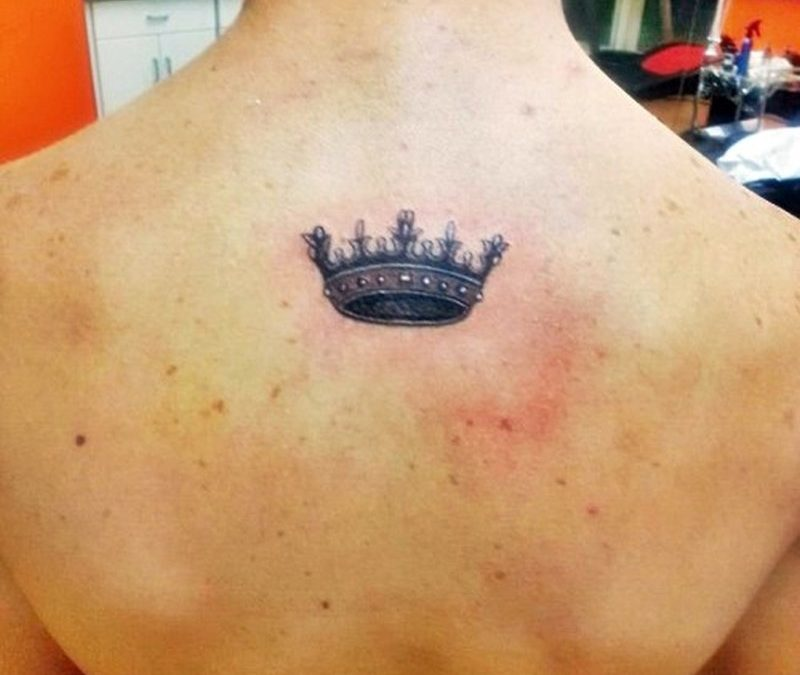 Cool crown tattoo on upper back for men