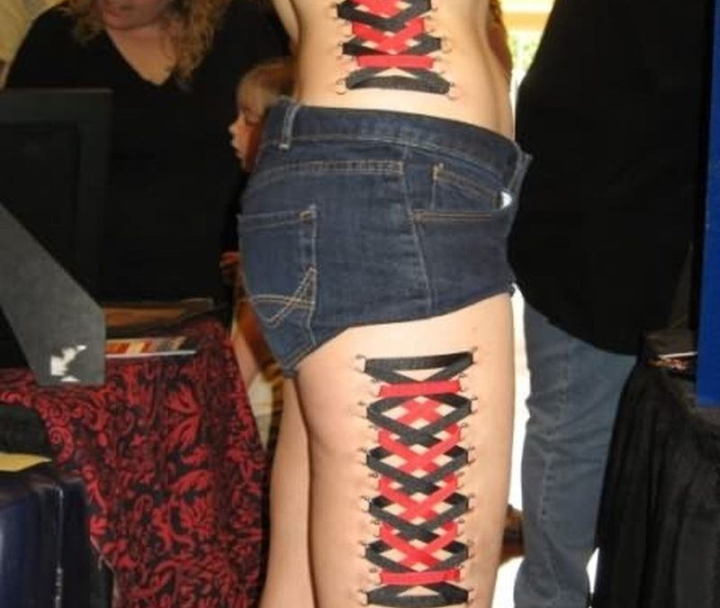 Corset tattoo on thigh rib