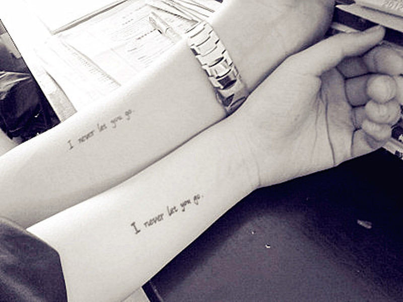 Couple have matching tattoo design