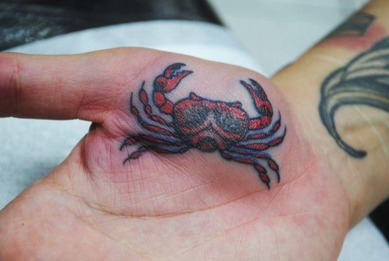 Crab tattoo on palm