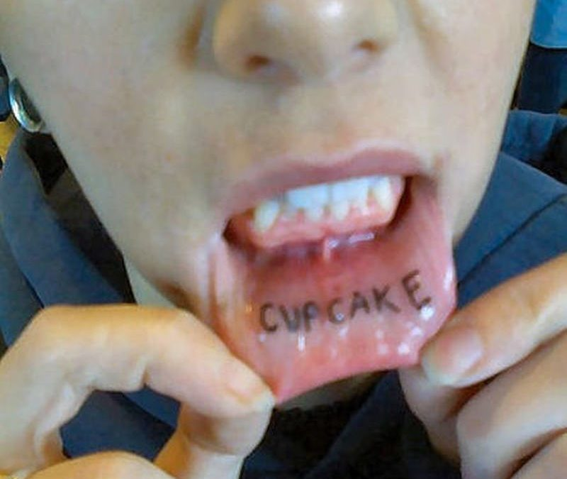 Cup cake tattoo on lip