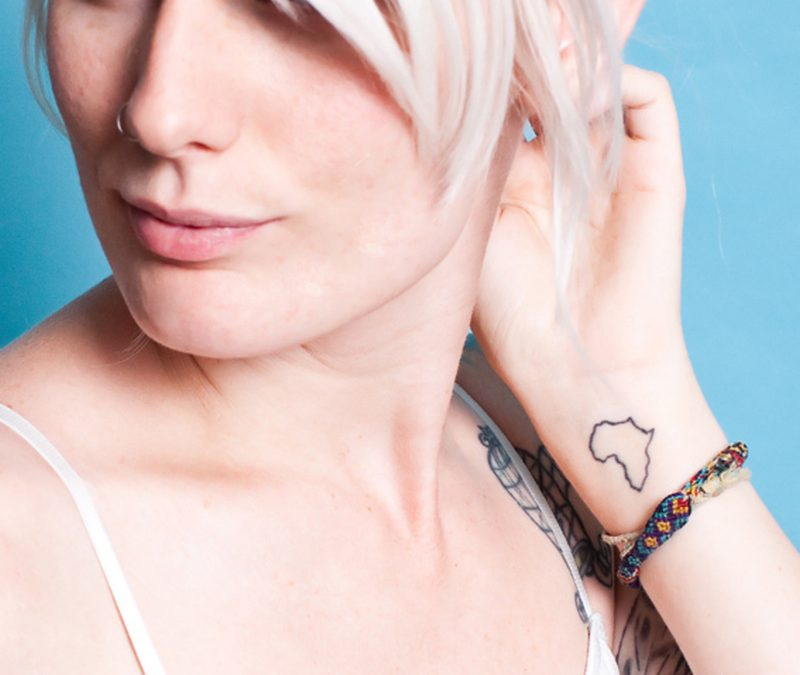 Cute african outline map tattoo on girl wrist
