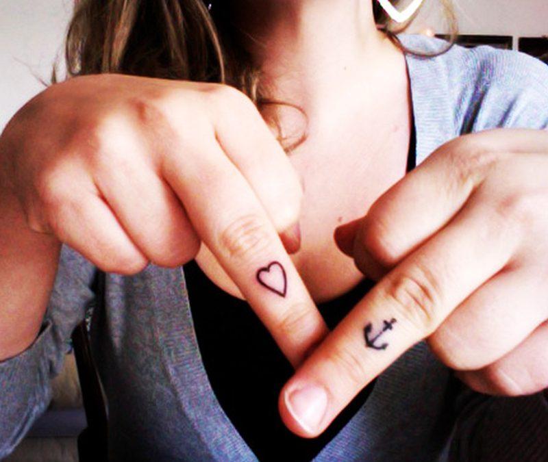 Cute heart anchor tattoo on fingers