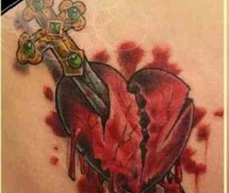 Dagger through a bleeding heart tattoo