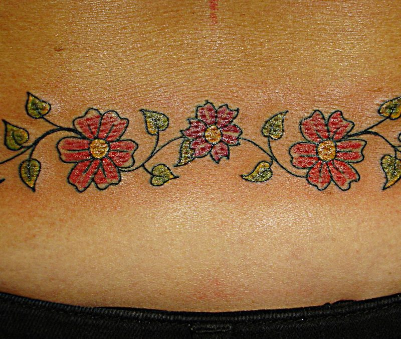 Daisy chain tattoo on lower back