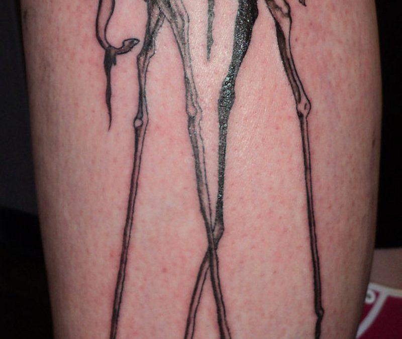 Dali elephant tattoo on leg