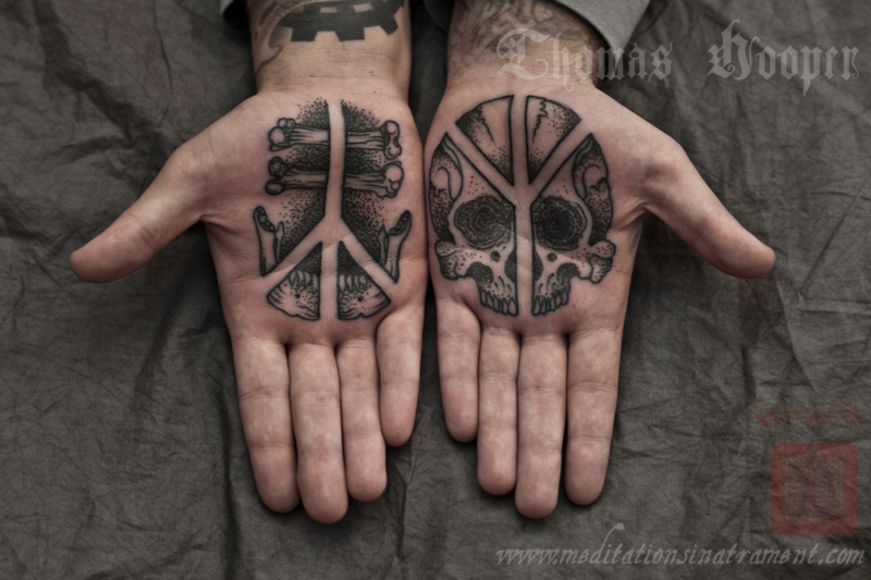 Death skull tattoo on palm