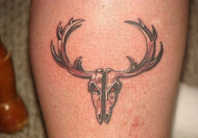 Deer skull tattoo on calf