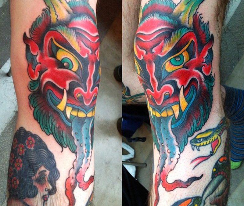 Demon head knee tattoo design