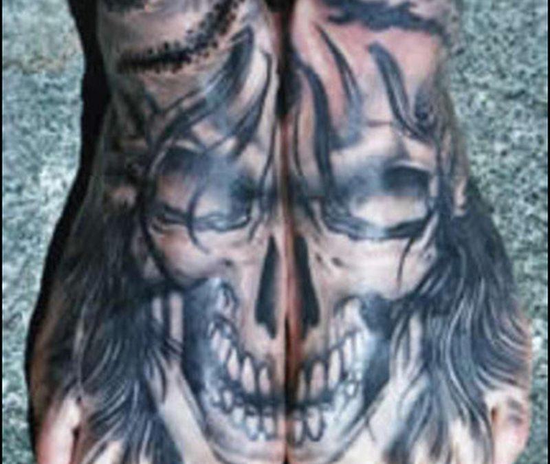 Demon tattoo design on feet