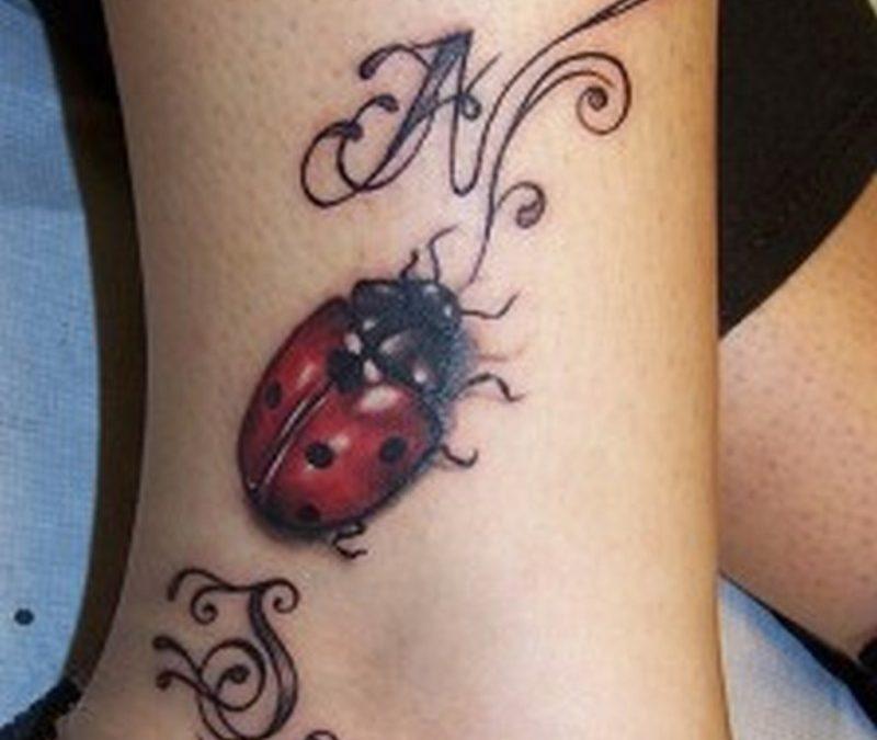 Designer lady bug tattoo