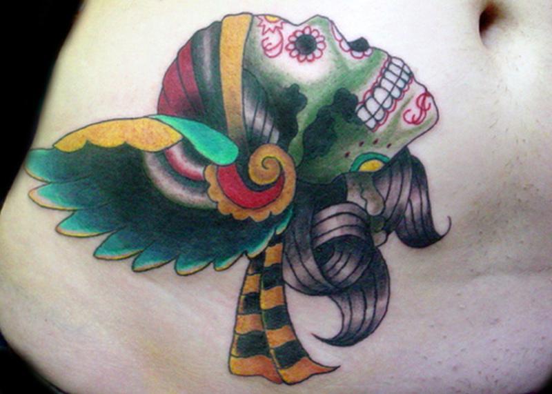 Dia de los muertos skull tattoo on belly