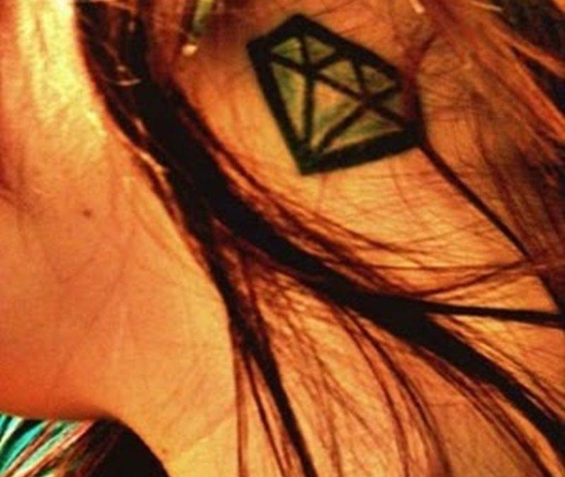 Diamond tattoo on neck