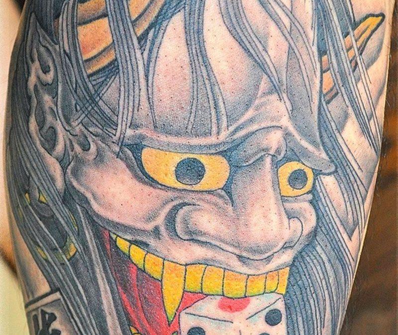 Dice in devil mouth tattoo design
