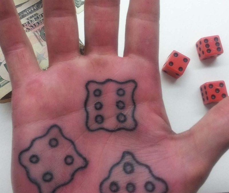 Dice tattoo design on palm