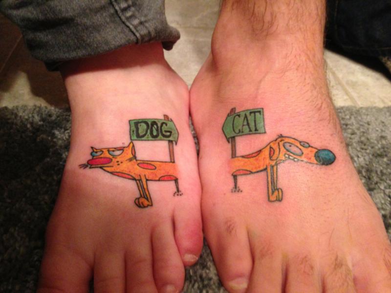 Dog cat friendship tattoo on feet
