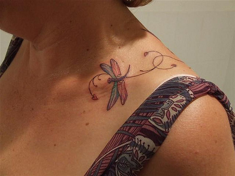 Dragonfly tattoo on collarbone