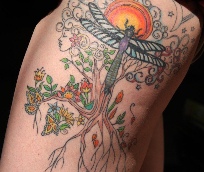 Dragonfly tattoo on upper leg