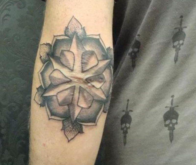 Elbow mandala tattoo design