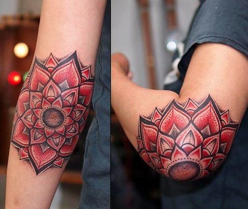 Elegant lotus flower tattoo on elbow