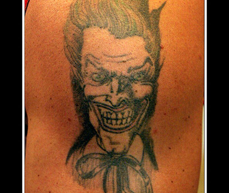 Evil joker tattoo photo 2