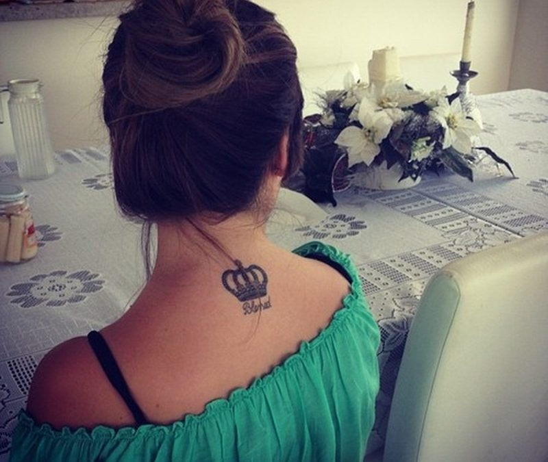 Fabulous crown tattoo on upper back 3