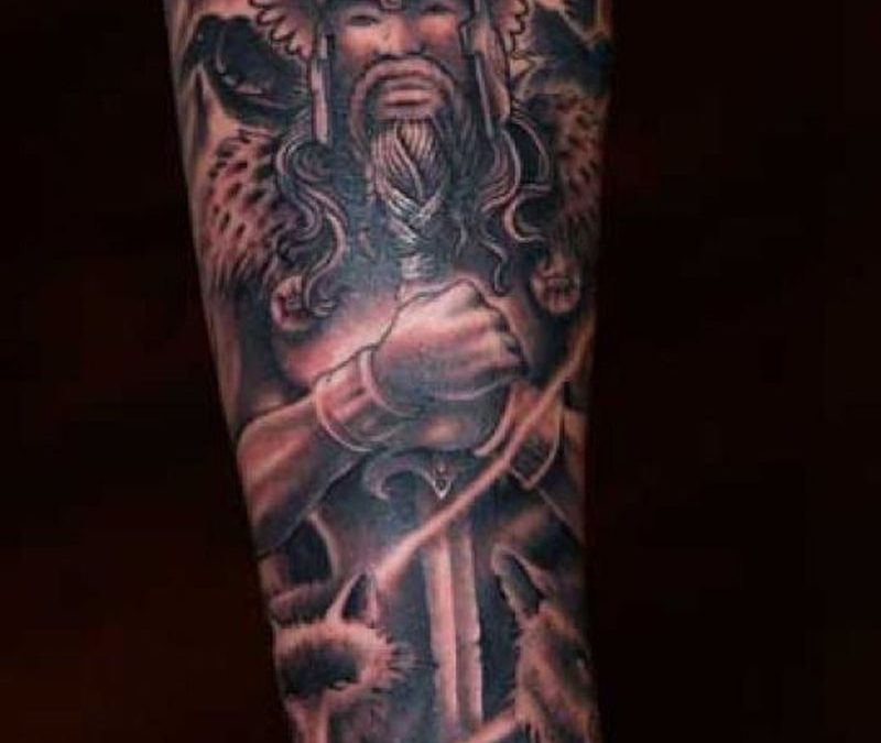 Fantasy on lower arm tattoo