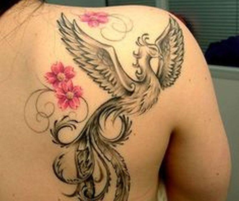 Feminine phoenix tattoo on back shoulder