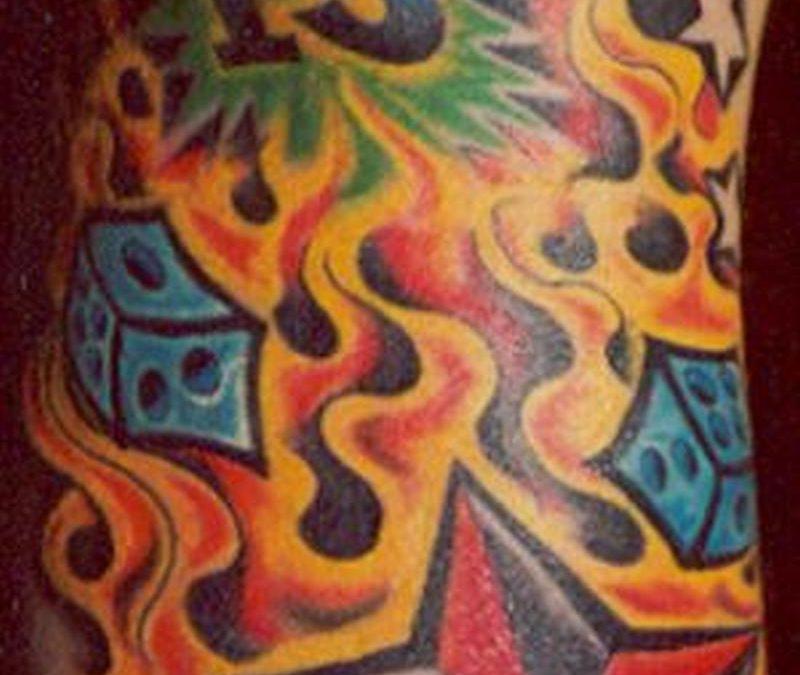 Flaming nautical star dice tattoo design