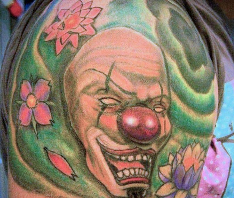 Funny clown tattoo on shoulder