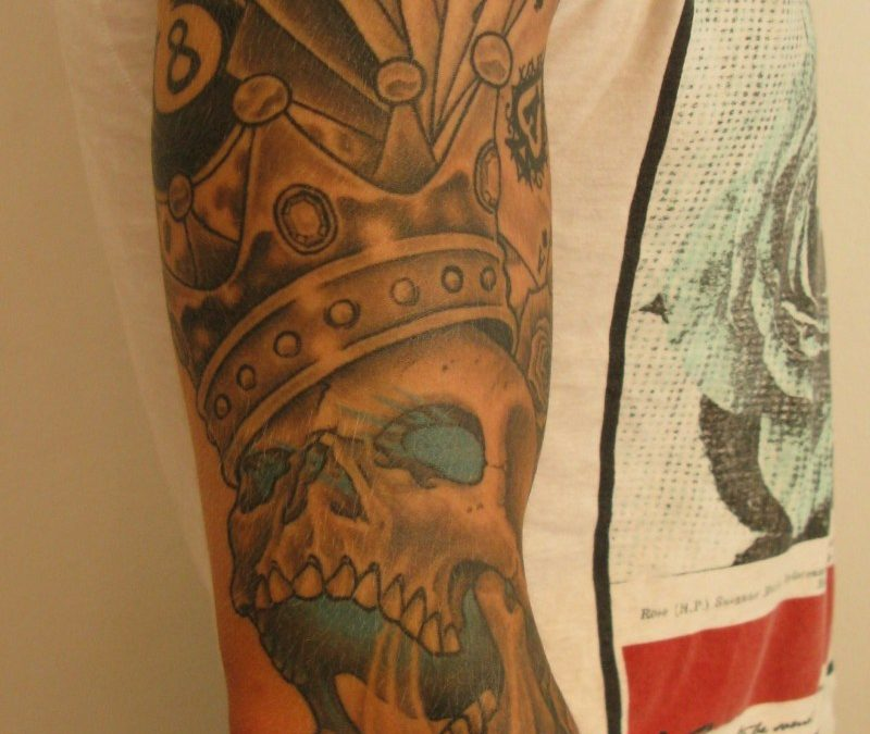 Gambling tattoo on right arm